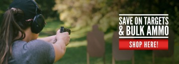 Woman firing at a shooting range with ammo and targets